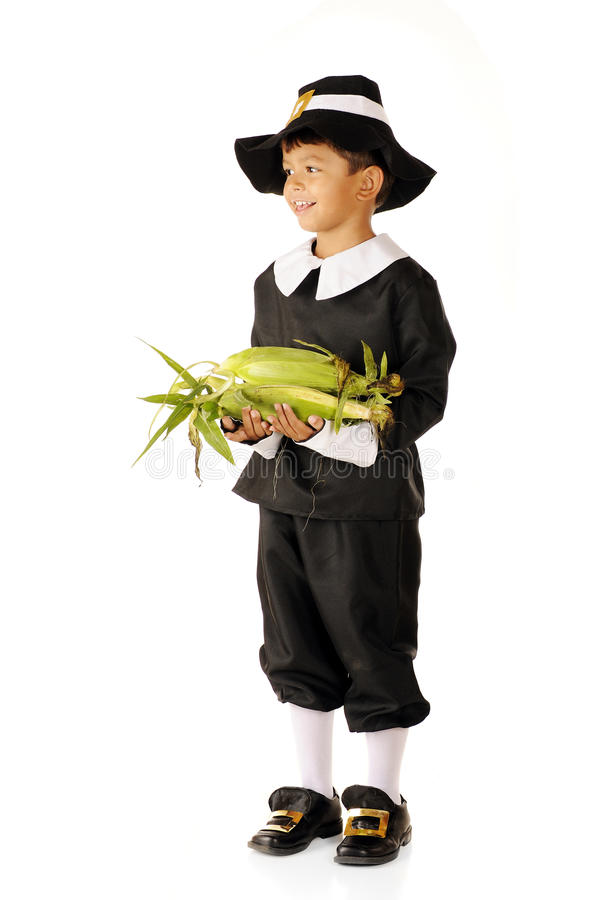 A Young Pilgrim's Thanksgiving Offering royalty free stock photo