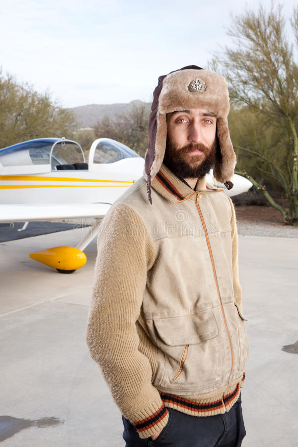 Download Young pilot on the runway stock image. Image of single - 12610321