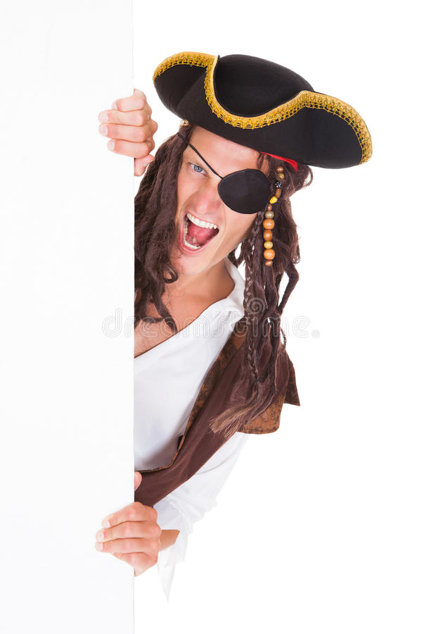 Young Pirate Pointing At Blank Placard royalty free stock photography