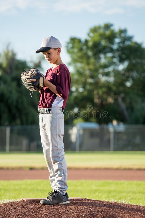 Young Pitcher Concentrating royalty free stock images