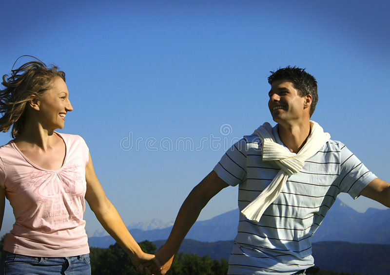 Young playful couple stock images