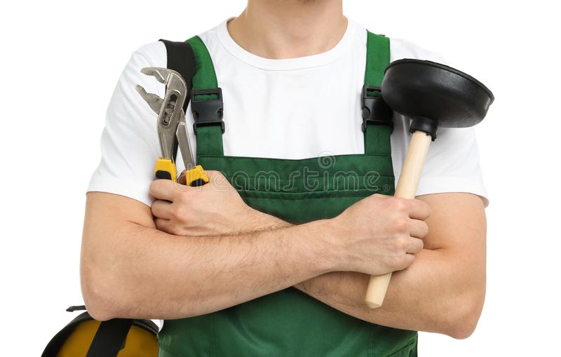 Young plumber with adjustable wrench and force cup. On white background stock images