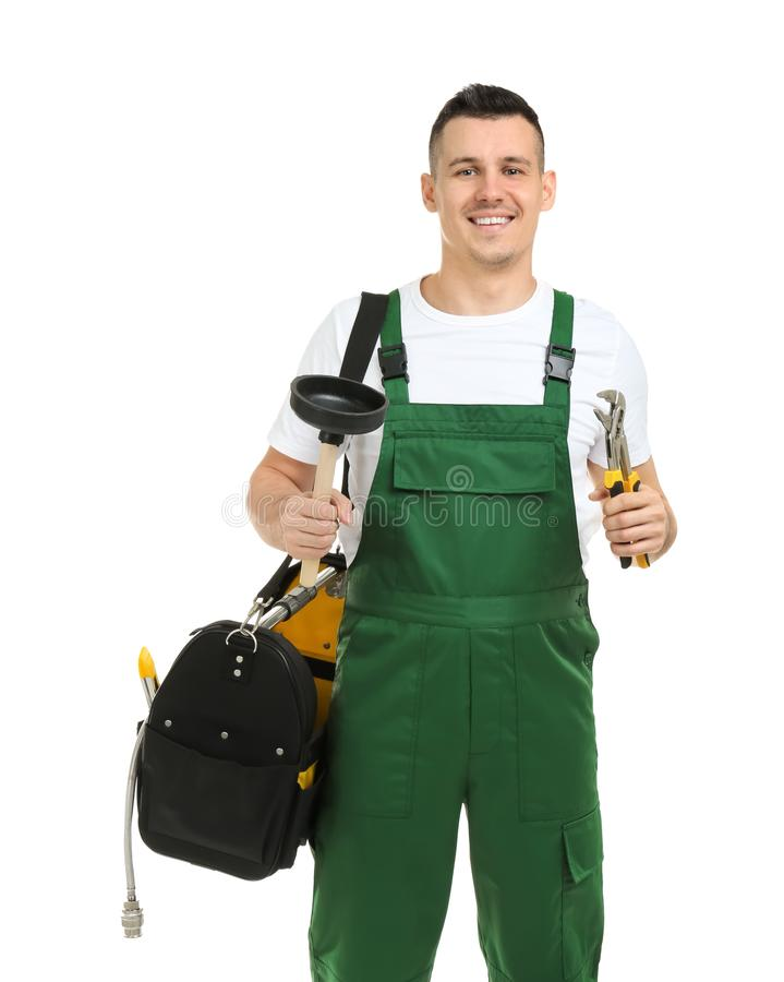 Young plumber with adjustable wrench and force cup. On white background stock photos