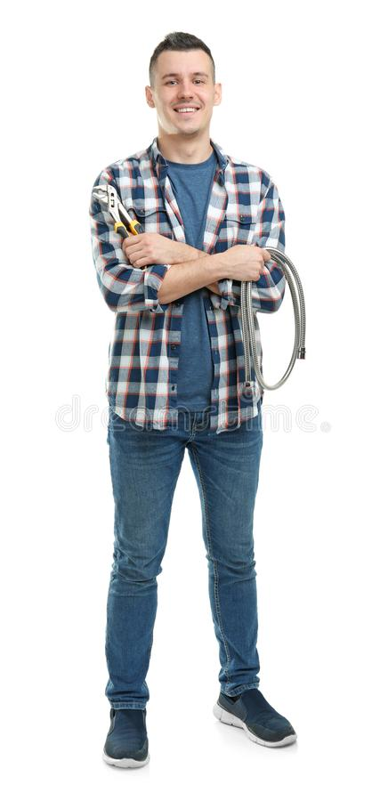 Young plumber with hose and adjustable wrench. On white background stock image