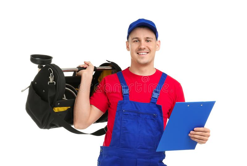 Young plumber with tool bag and clipboard. On white background stock images