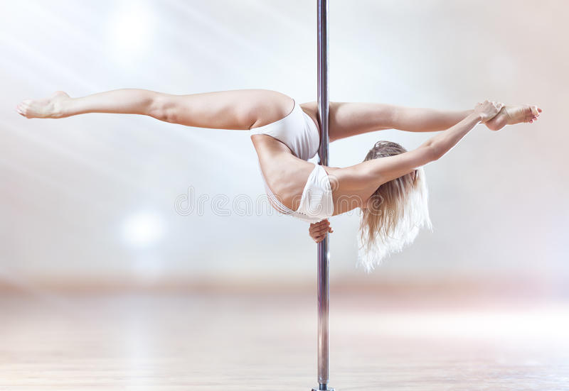 Download Young pole dance woman stock photo. Image of down, body - 18467478