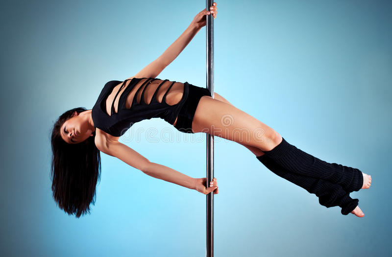 Young pole dance woman royalty free stock images