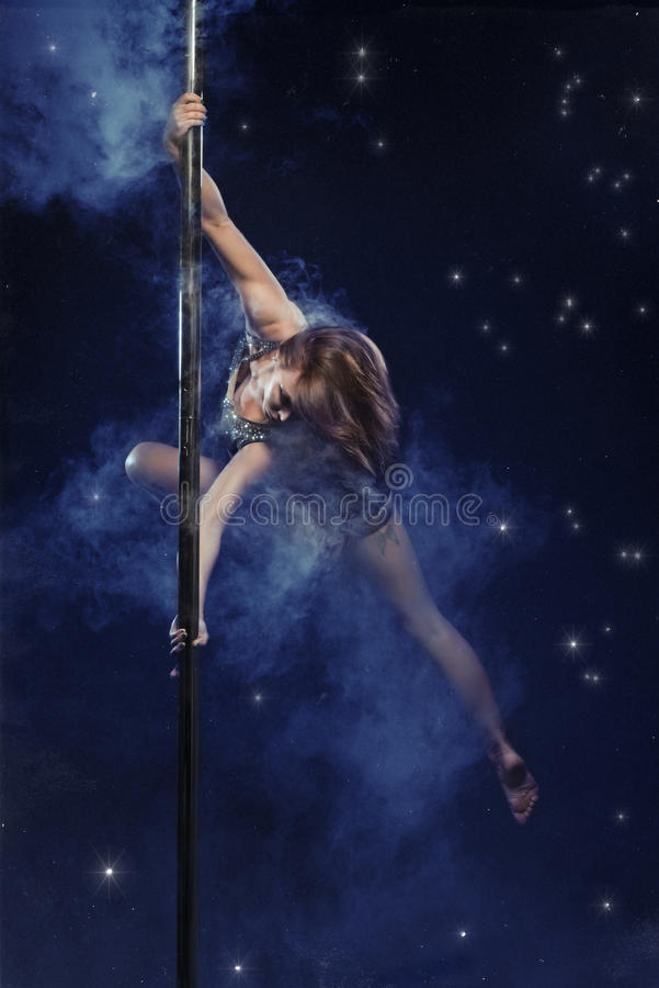 Young pole dance woman. stock photo