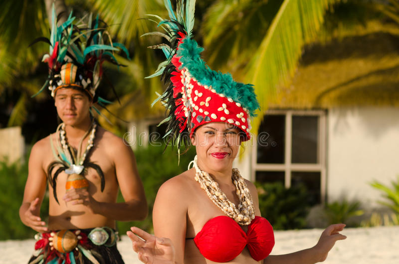 Young Polynesian Pacific Island Tahitian Dancers Couple. Portrait of attractive young Polynesian Pacific Island Tahitian male and female dancers in colorful stock images