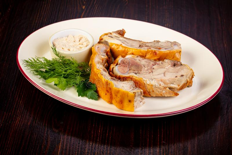 Young pork meat. With sauce stock image
