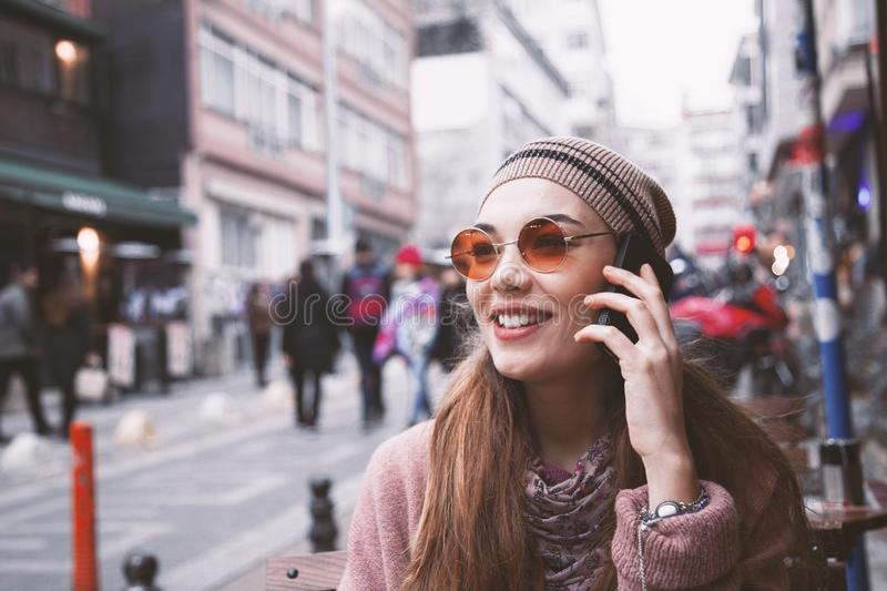 Young portrait woman talking mobile phone in outdoors stock photos