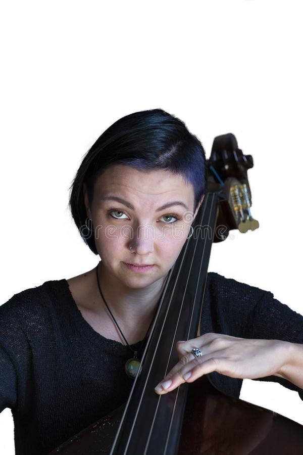 Young positive brunette playing double bass Isolated image on white background stock photography