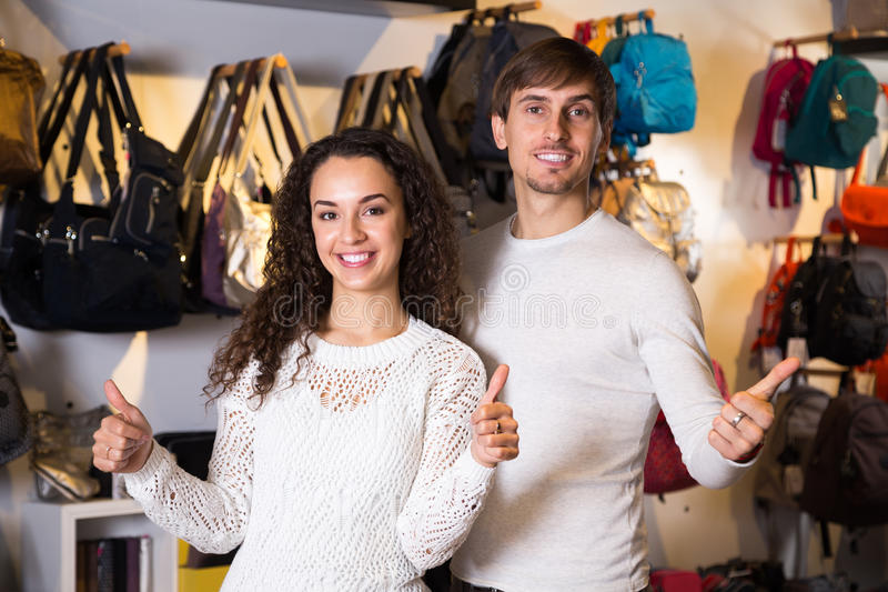 Young positive customers in haberdashery shop royalty free stock photo