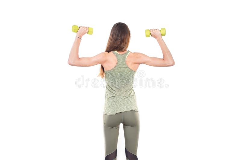 Young positive smiling woman working out with weights royalty free stock images