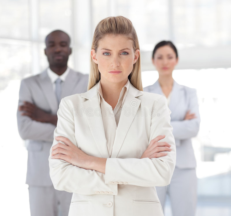 Young Powerful looking business woman. Looking at camera royalty free stock image