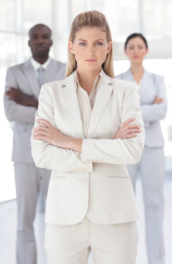 Young Powerful looking business woman. Looking at camera arms folded stock photo