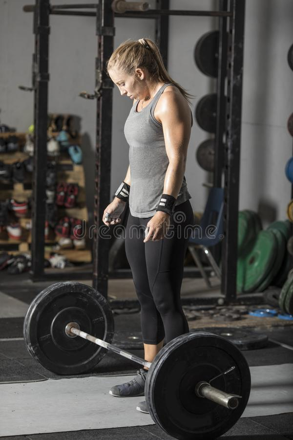 Young powerful woman preparing for deadlift stock images
