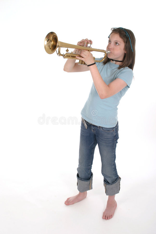 Young Pre Teen Girl Playing Trumpet 2 royalty free stock photo