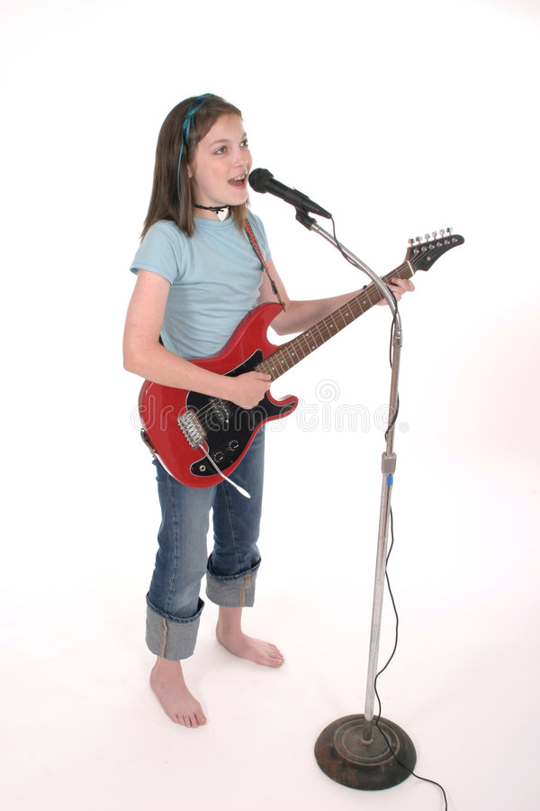 Young Pre Teen Girl Singing With Guitar 6 royalty free stock photography