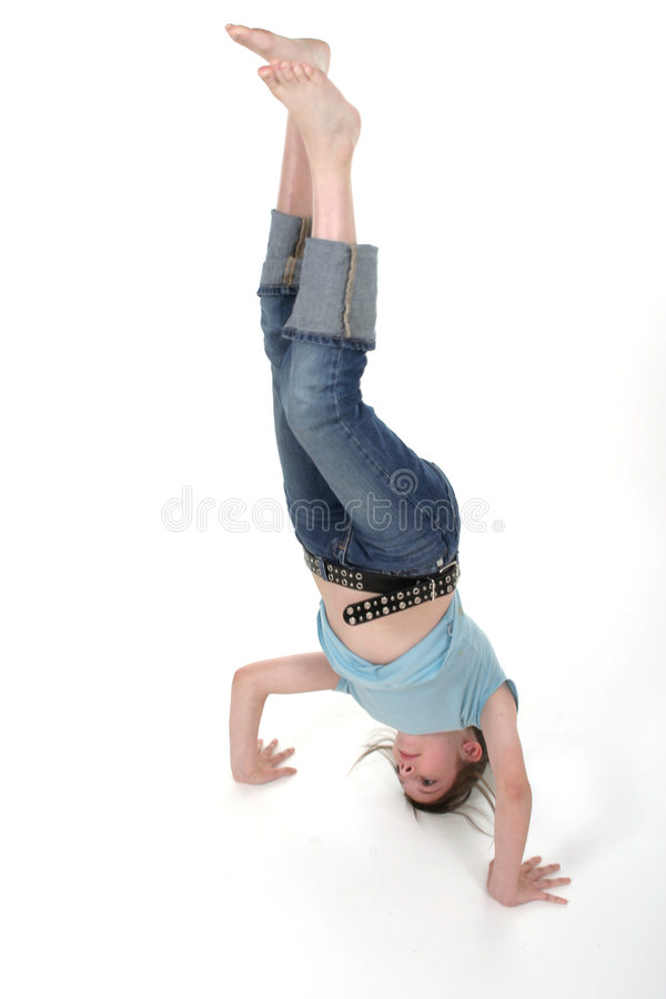 Download Young Pre Teen Girl Standing On Her Head 2 Stock Photo - Image: 917474