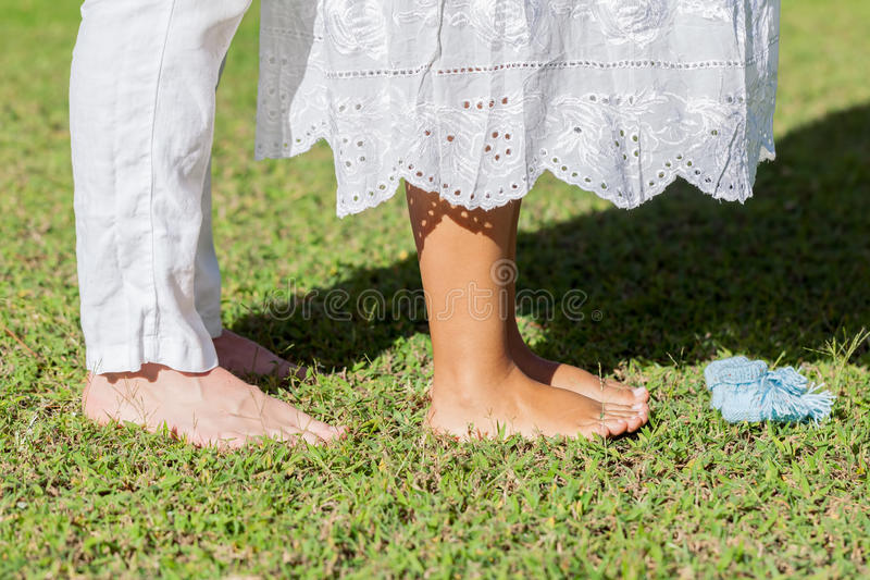 Young Pregnant Couple Feet stock photography