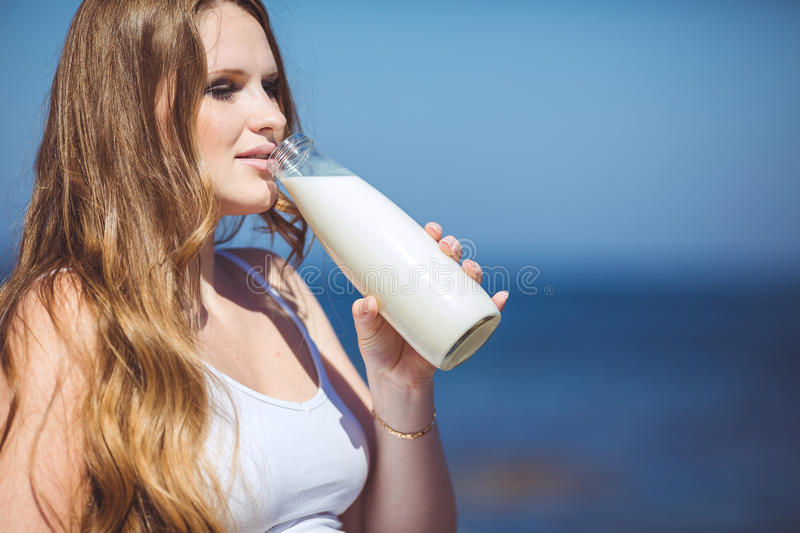 Download Young Pregnant Woman Breathes The Fresh Sea Air On A Background Of Mountains Stock Image - Image: 36720185