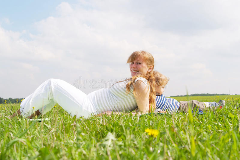 Download Young Pregnant Woman With Her Son Stock Image - Image: 12943067
