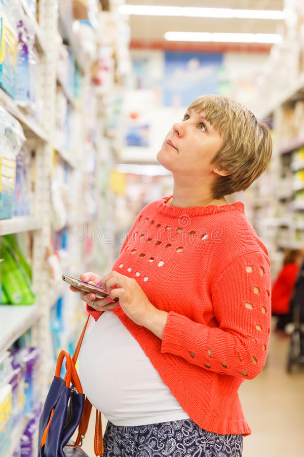 Young pregnant woman in shopping mall royalty free stock image