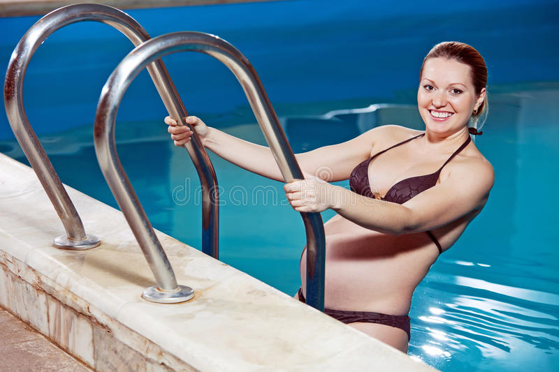 Young pregnant woman in a swimming pool stock image