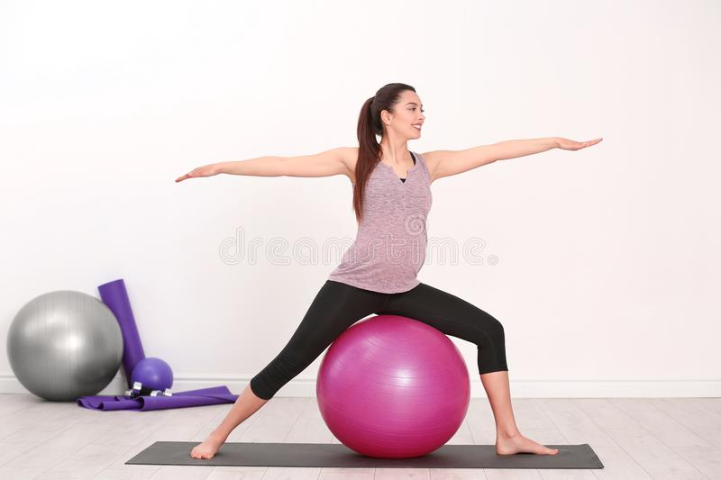 Young pregnant woman training in gym. stock photo