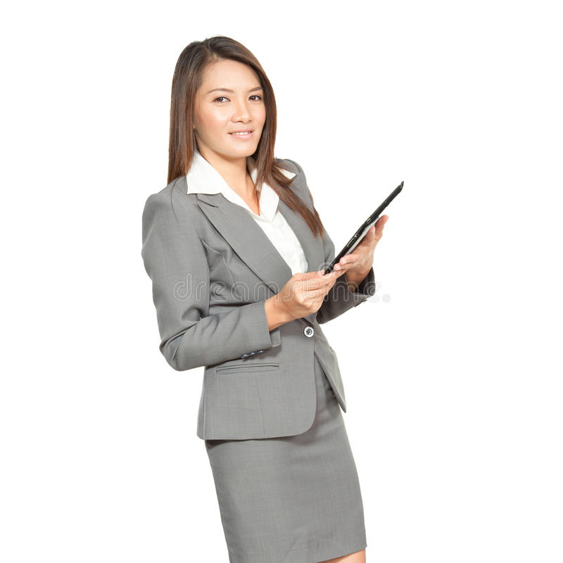Young pretty Asian business woman gesture using a tablet smiling stock photography
