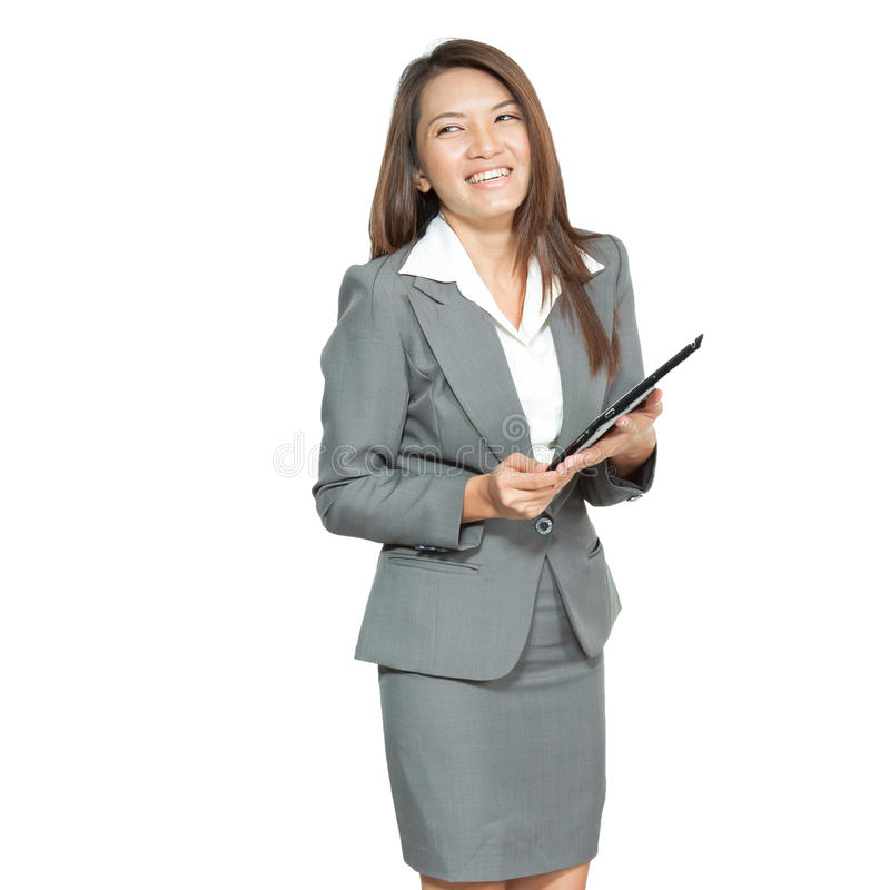 Young pretty Asian business woman gesture using a tablet smiling royalty free stock photos