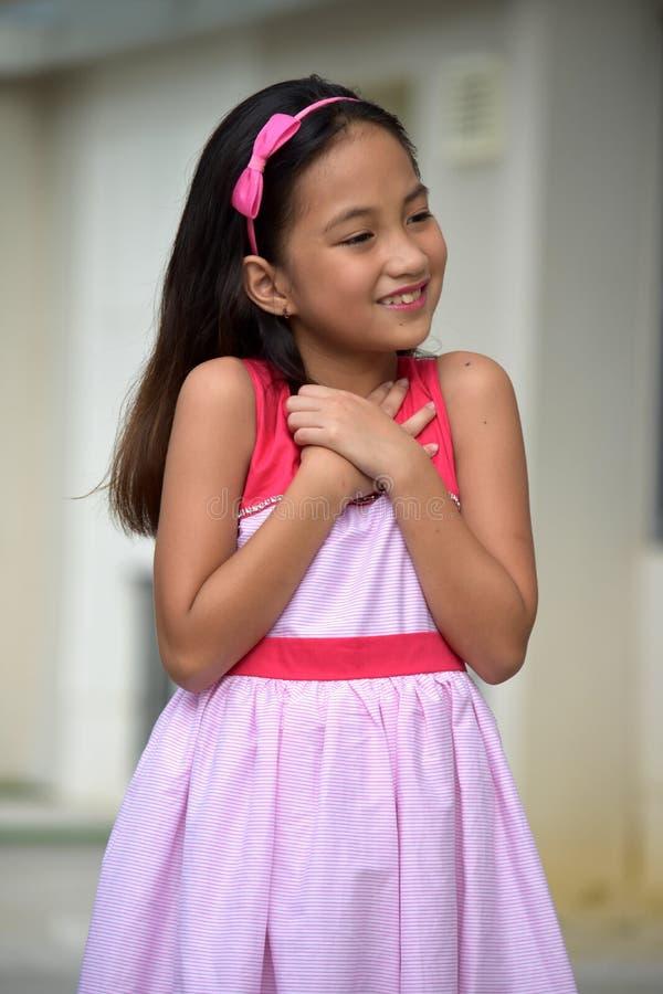 Appreciative Cute Teen Girl. A young pretty asian girl child stock photography