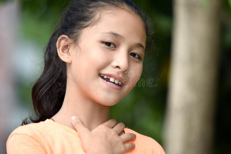 An Appreciative Female Juvenile. A young pretty asian girl child stock images
