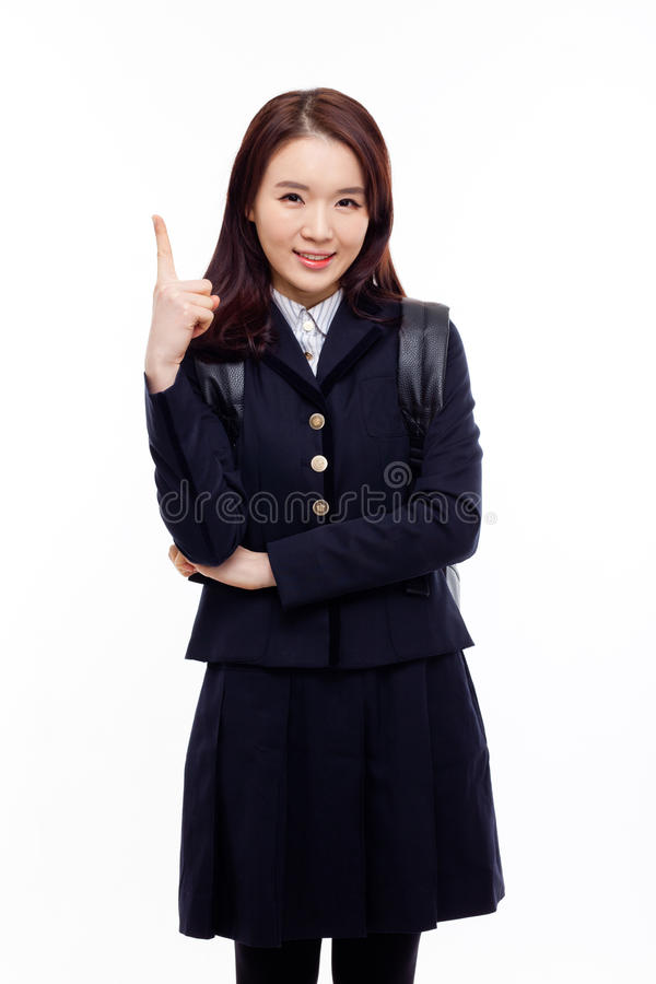 Young pretty Asian student indicate side space stock photo