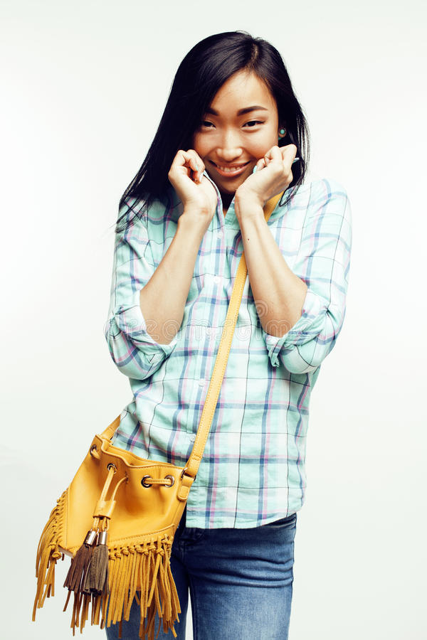 Young pretty asian woman posing cheerful emotional on white background, lifestyle people concept. Close up stock image