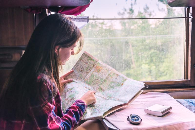 Girl with a compass and a map royalty free stock images