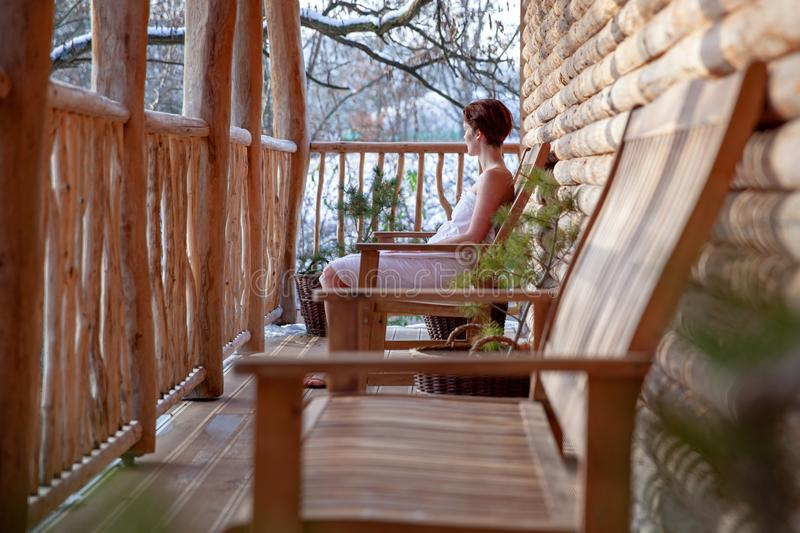 Young attractive woman enjoying wellness with sauna and swimming pool outdoors in winter royalty free stock photos