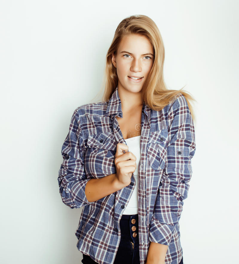 Young pretty blond girl hipster posing frendly against white background wall, smiling woman with long hair royalty free stock images