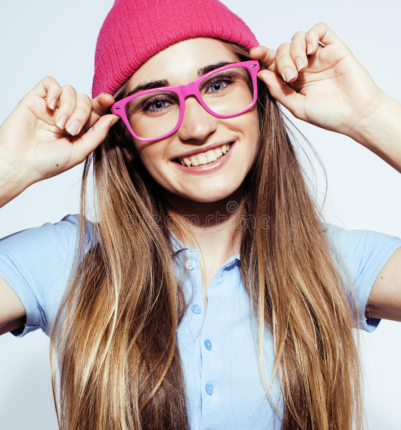 Young pretty blond teenage girl emotional posing, happy smiling isolated on white background, lifestyle people concept. Close up stock photography