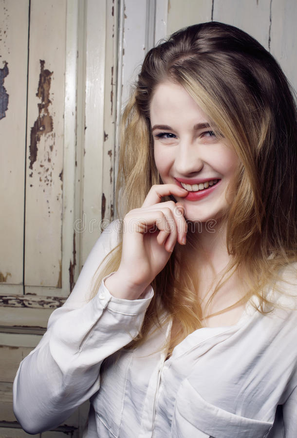 Young pretty blond teenage happy smiling girl close up portrait, lifestyle people concept stock image