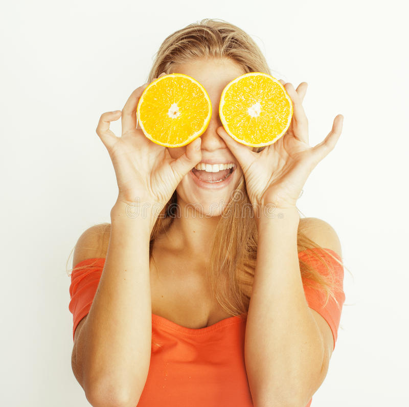 Young pretty blond woman with half oranges close royalty free stock photography