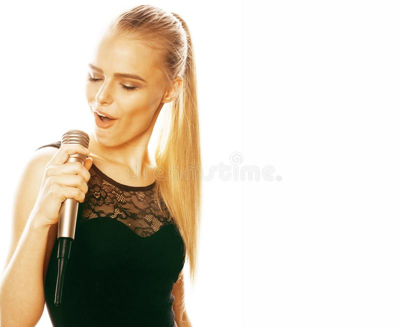 Young pretty blond woman singing in microphone isolated close up karaoke stock photos