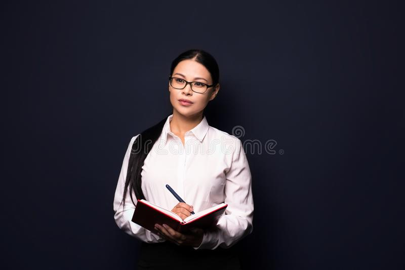 Young pretty business woman making notes royalty free stock photos