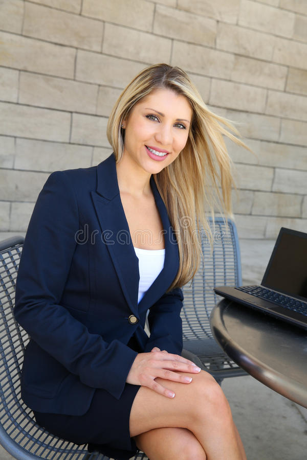 Young pretty business woman with a notebook royalty free stock images