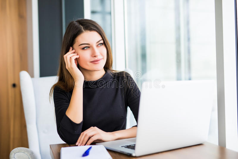 Young pretty business woman with notebook in the bright modern office royalty free stock photos