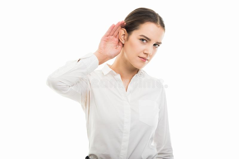 Young pretty business woman showing can`t hear you gesture royalty free stock photos
