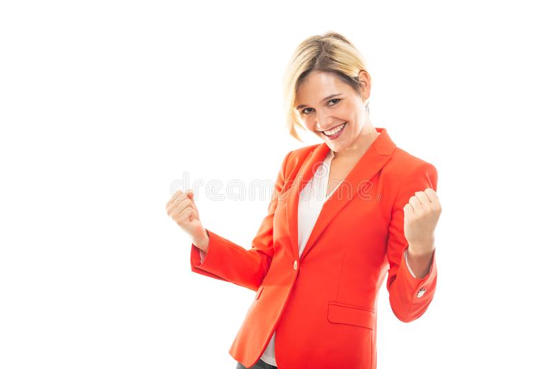 Young pretty business woman showing winning gesture royalty free stock photography