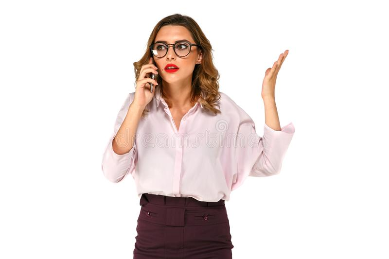 Beautiful business woman talking on the smartphone royalty free stock photography