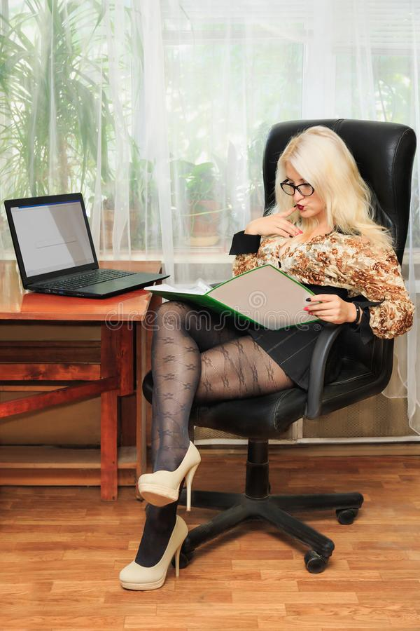 Young pretty business woman working in office stock photos